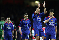 Photo: Paul Thomas.<br /> Arsenal v Manchester United. The Barclays Premiership. 21/01/2007.<br /> <br /> Rio Ferdinand (2nd R) and his dejected team-mates thank their traveling fans after the match.