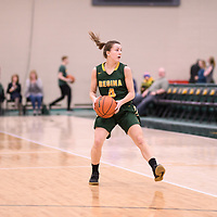 3rd year guard Avery Pearce (4) of the Regina Cougars in action during the Women's Basketball Playoff Game on February  16 at Centre for Kinesiology, Health and Sport. Credit: Arthur Ward/Arthur Images