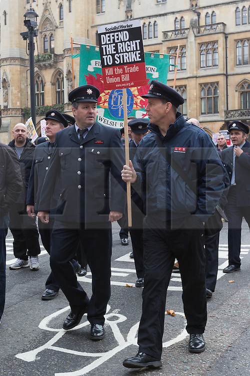 © Licensed to London News Pictures. 02/11/2015. London, UK. Members of the Fire Brigade Union (FBU) and supporters arrive to participate in a rally against the Trade Union Bill and the right to strike in Westminster, London. Photo credit : Vickie Flores/LNP