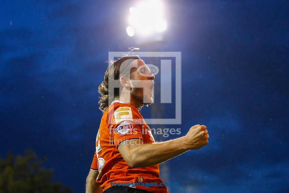 Luke Rooney of Luton Town celebrates scoring the opening goal during the Capital One Cup match at Kenilworth Road, Luton<br /> Picture by David Horn/Focus Images Ltd +44 7545 970036<br /> 12/08/2014