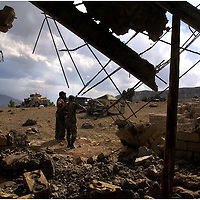 Members of the Afghanistan National Army(ANA) stand near the section of the clinic being built in shembawat, Afghanistan that was damaged from hand grenadies about a week and a half ago  Lt. Col George Donovan spoke to the towns people about recent attacks on the school and clinic the army  is costructing. Donovan sent a stern message to the towns people that no construction of the clinic or school will continue until they find who is responsible for recent attacks on the buildings.