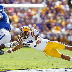 October 1, 2011; Baton Rouge, LA, USA;  LSU Tigers cornerback Tyrann Mathieu (7) makes a diving attempt to tackle Kentucky Wildcats wide receiver La'Rod King (16) during the second quarter at Tiger Stadium.  Mandatory Credit: Derick E. Hingle-US PRESSWIRE / © Derick E. Hingle 2011