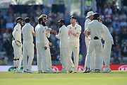 Moeen Ali and England celebrate the wicket of Virat Kohli during the fourth day of the 4th SpecSavers International Test Match 2018 match between England and India at the Ageas Bowl, Southampton, United Kingdom on 2 September 2018.