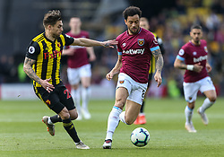 West Ham United's Felipe Anderson and Watford's Kiko Femenia during the Premier League match at Vicarage Road, Watford.