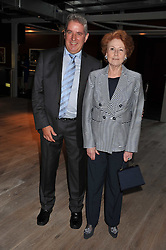 LADY ELIZABETH ANSON and STUART HOLMES at a party to celebrate the publication of Joan Collin's  autobiography - The World According to Joan, held at the British Film Institute, South Bank, London SE1 on 8th September 2011.