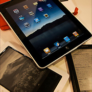 Grouping of different e-book readers, i-pad, Sony, Nook and BE Book.  E-book reader, also called an e-book device or e-reader, is an electronic device that is designed primarily for the purpose of reading digital books and periodicals.