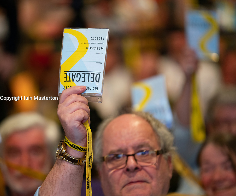 Edinburgh, Scotland, UK. 27 April, 2019. SNP ( Scottish National Party) Spring Conference takes place at the EICC ( Edinburgh International Conference Centre) in Edinburgh. Pictured; Male delegate voting during a session on day 1.