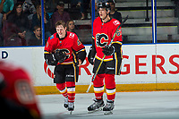 PENTICTON, CANADA - SEPTEMBER 10: Matthew Phillips #47 and Adam Ruzicka #63 of Calgary Flames skate to the bench against the Vancouver Canucks on September 10, 2017 at the South Okanagan Event Centre in Penticton, British Columbia, Canada.  (Photo by Marissa Baecker/Shoot the Breeze)  *** Local Caption ***