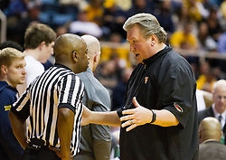 Jan 20, 2016; Morgantown, WV, USA; West Virginia Mountaineers head coach Bob Huggins talks to an official during a timeout during the first half against the Texas Longhorns at the WVU Coliseum. Mandatory Credit: Ben Queen-USA TODAY Sports