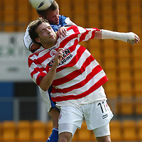 St Johnstone v Hamilton Accies..31.07.04  Bell's Cup<br />Mark Corcoran loses out to Jordan Tait<br /><br />Picture by Graeme Hart.<br />Copyright Perthshire Picture Agency<br />Tel: 01738 623350  Mobile: 07990 594431