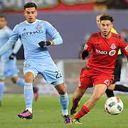 NEW YORK, NEW YORK - November 06:  Ronald Matarrita #22 of New York City FC is challenged by Jonathan Osorio #21 of Toronto FC during the NYCFC Vs Toronto FC MLS playoff game at Yankee Stadium on November 06, 2016 in New York City. (Photo by Tim Clayton/Corbis via Getty Images)