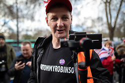 """© Licensed to London News Pictures . 09/12/2018 . London , UK . A man wears an """" I am Tommy Robinson """" t-shirt and video records press at a demonstration in support of Brexit , headed by a coalition led by UKIP leader Gerard Batten and former EDL leader Stephen Yaxley-Lennon ( aka Tommy Robinson ) , in Westminster . Photo credit: Joel Goodman/LNP"""