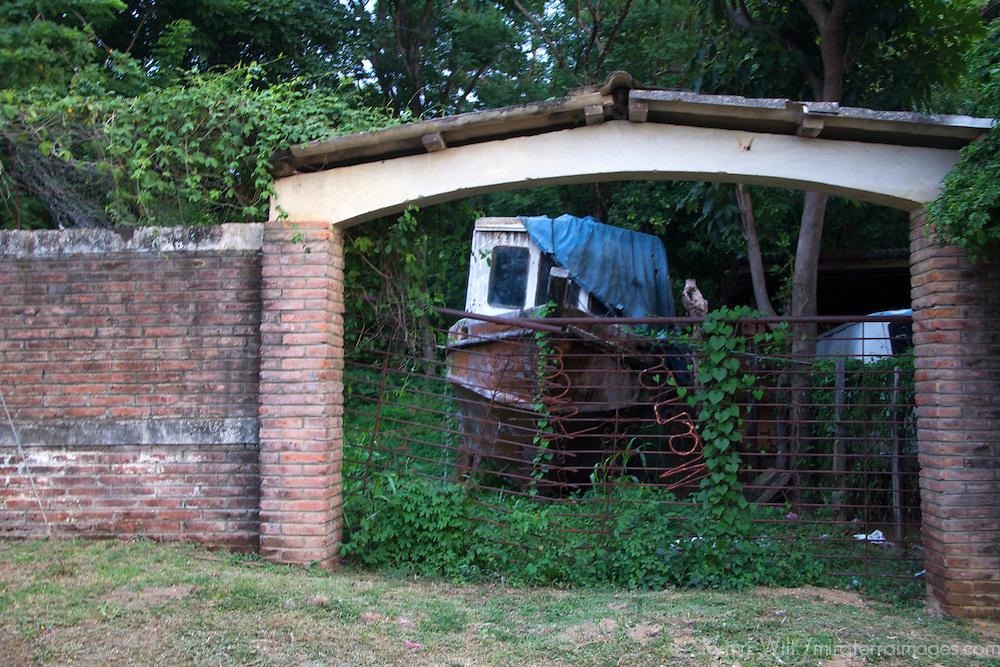Central America, Nicaragua, San Juan del Sur. Rusty boat and bricks in San Juan del Sur, Nicaragua.