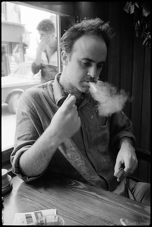 Nicholas Birch, journalist, smokes a cigarette in his neighborhood cafeteria in the Galata neighbood of Istanbul, Turkey.