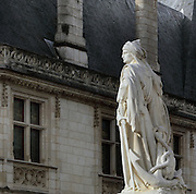 Marble statue of Jacques Coeur, 1395-1456, by Auguste Preault, 1809-79, 1874, inaugurated 1879, outside the Palais Jacques Coeur, on the Place Jacques Coeur, Bourges, France. Jacques Coeur was a wealthy merchant and was made master of the mint to King Charles VII in 1438. He had his huge manor house built 1443-51 in Flamboyant Gothic style although he never lived there. The building is listed as a historic monument. Picture by Manuel Cohen