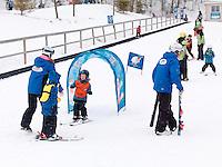 Children learning to ski at Blue Mountain, Collingwood, Ontario, Canada alpine ski resort.