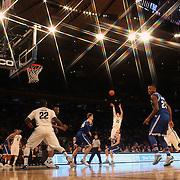 Ryan Arcidiacono, Villanova, shoots during the Villanova Wildcats Vs Seton Hall Pirates basketball game during the Big East Conference Tournament at Madison Square Garden, New York, USA. 12th March 2014. Photo Tim Clayton