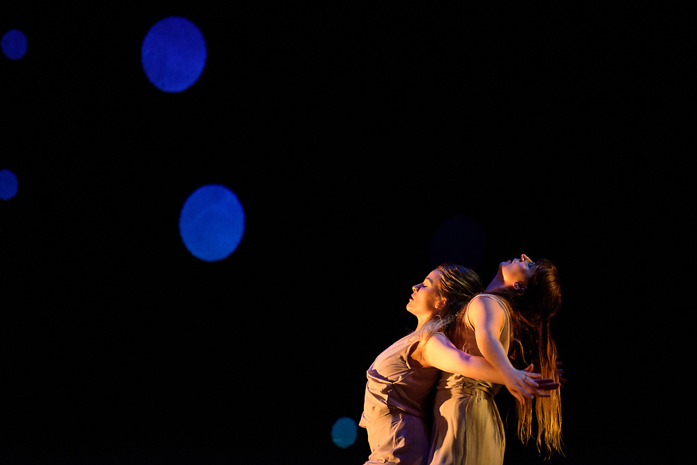 Baltimore, Maryland - April 25, 2017: Constellations (Cait McAfee, choreographer)<br /> Distance collaboration with choreographer Sarah Joy Stallsmith (FL) and sound designer Arjun Bhamra (London), Cait McAfee creates Constellations using collaborative practices to navigate the relationship between geographical and emotional relationships.  <br /> This piece uses projection which is shown against the back wall.  <br /> <br /> Baltimore modern dance company The Collective's annual concert &quot;This is Home&quot; at the Baltimore Theatre Project. <br /> <br /> <br /> CREDIT: Matt Roth