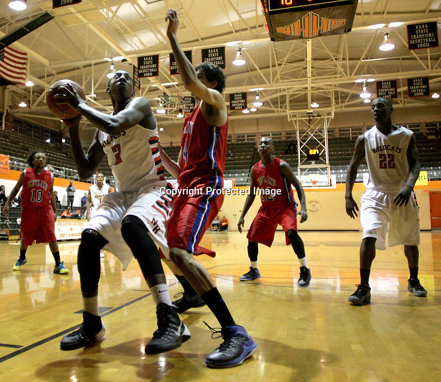 New Hanover's Lawrence Williams looks to shoot over Scotland County's Jeremias Eastering. (Jason A. Frizzelle)