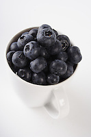 Blueberries in white cup - close-up