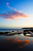 Sunset on Red Strand, in Dunowen, near Galley Head, West Cork. Cloud reflected in tidal pool