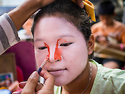 18 JANUARY 2015 - BANGKOK, THAILAND:  A performer with the Sai Yong Hong Opera Troupe puts on her make up before performing at the Chaomae Thapthim Shrine, a Chinese shrine in a working class neighborhood of Bangkok near the Chulalongkorn University campus. The troupe's nine night performance at the shrine is an annual tradition and is the start of the Lunar New Year celebrations in the neighborhood. The performance is the shrine's way of thanking the Gods for making the year that is ending a successful one. Lunar New Year, also called Chinese New Year, is officially February 19 this year. Teochew opera is a form of Chinese opera that is popular in Thailand and Malaysia.             PHOTO BY JACK KURTZ