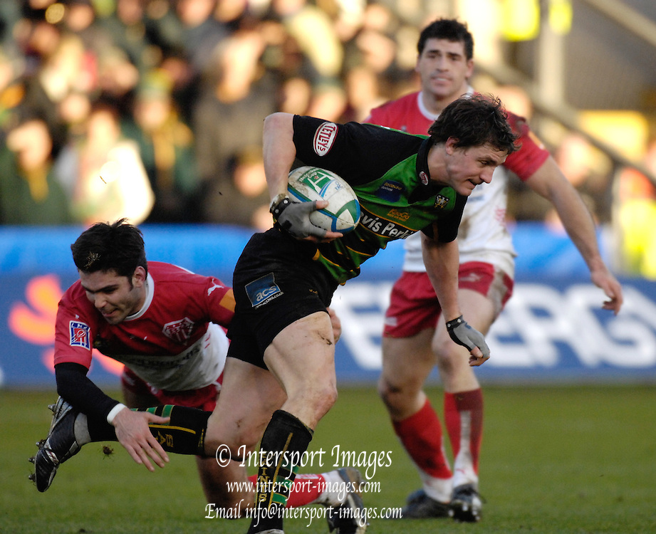 Northampton, GREAT BRITAIN, Saints Sean LAMONT is tackle by Dimitri YACHVILI, during the match, Northampton Saints vs Barritz, played at the Franklin Gardens, England, on Sun 21.01.2007  [Photo, Peter Spurrier/Intersport-images].....