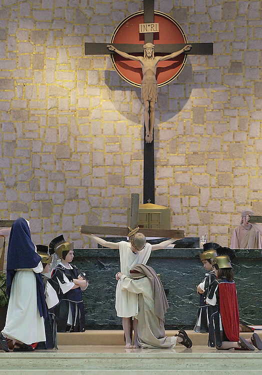 Youth perform a living Stations of the Cross during Lent at Mater Dei Chapel in St. Francis, Wis. (Photo by Sam Lucero)