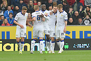 Leeds United celebrate Chris Wood (9) scoring to go 1-0 up  during the Sky Bet Championship match between Hull City and Leeds United at the KC Stadium, Kingston upon Hull, England on 23 April 2016. Photo by Ian Lyall.