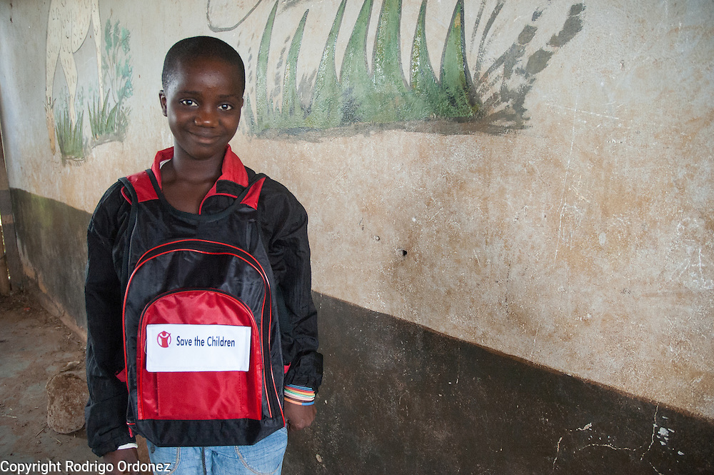 Mariana, 12, poses for a photograph in the school yard. <br /> Save the Children distributed education kits to students at Groupe Scolaire Quartier Lyc&eacute;e in Man, western C&ocirc;te d'Ivoire. Children received a backpack with school supplies such as pens, pencils, sharpeners, notebooks, rulers, a pair of compasses and a portable chalkboard.