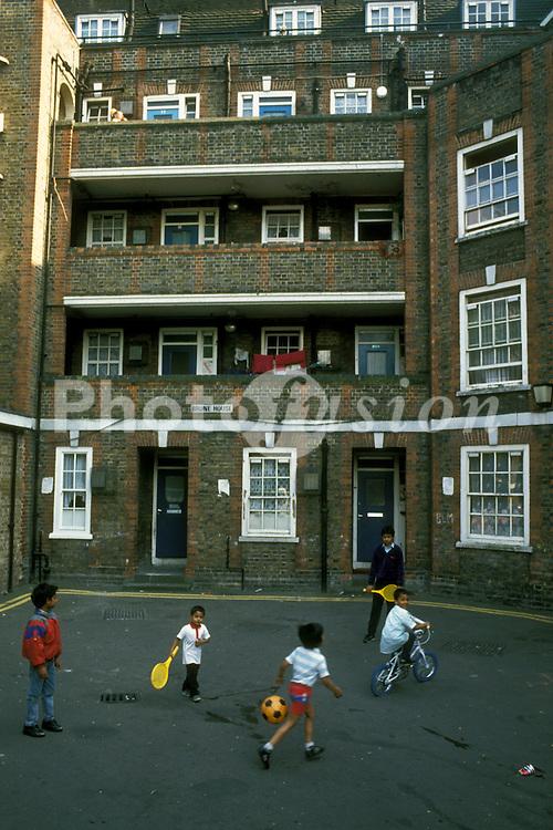 Bengali children playing on Spitalfields council housing estate; Tower Hamlets; East London UK