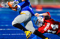 South's Tyler Crandall, of Folsom High School (14), attempts to tackle the south running back of the Sacramento Bee Optimist All-Star Game at Folsom High School, Saturday December 27, 2014. <br /> Brian Baer/Special to the Bee