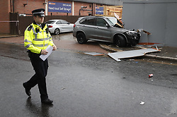 © Licensed to London News Pictures. 14/07/2019. London, UK. A damaged BMW X5 remains  near Lombard Road in Battersea, south west London after a car was driven into a group of people leaving a hotel. Three men have been arrested on suspicion of murder after the incident which took place at 11. 15pm on Saturday night. One man has a broken leg and six other people also sustained minor injuries. Photo credit: Peter Macdiarmid/LNP