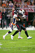 Arizona Cardinals wide receiver Chad Williams (10) gets tackled from behind by Denver Broncos cornerback Chris Harris Jr. (25) as Williams catches a third quarter pass for a gain of 16 yards and a first down at the Broncos 47 yard line during the NFL week 7 regular season football game against the Denver Broncos on Thursday, Oct. 18, 2018 in Glendale, Ariz. The Broncos won the game 45-10. (©Paul Anthony Spinelli)