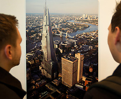 © Licensed to London News Pictures. 22/10/2012. LONDON, UK. Two members of the public view 'Shard Ortho', an altered version of London's Southwark Cathedral created using computer generated graphics, painting and photoshop for the computer game 'Dishonored' [sic], by Sebastian Mitton and Victor Antonov at an exhibition at London's City Hall. The exhibition, entitled 'The Games Art Festival', showcases the best of videogame art and runs from the 22nd to the 26th of October as part of the 'London Games Festival 2012'. Photo credit: Matt Cetti-Roberts/LNP