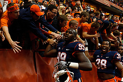 Oct 21, 2011; Syracuse NY, USA;  Syracuse Orange defensive end Chandler Jones (99) and linebacker Cameron Lynch (38) celebrate with fans after the game against the West Virginia Mountaineers at the Carrier Dome.  Syracuse defeated West Virginia 49-23. Mandatory Credit: Jason O. Watson-US PRESSWIRE
