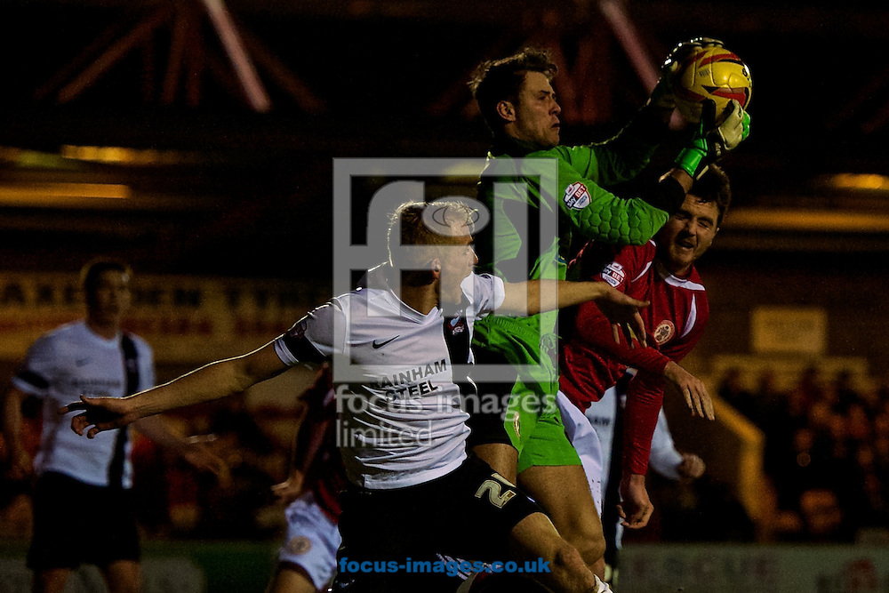 **CAPTION CORRECTION ** Marcus Bettinelli of ac claims the ball during the Sky Bet League 2 match at the Fraser Eagle Stadium, Accrington<br />
