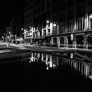 FRANCE. Paris, Ile-de-France. November 11th, 2013. Shadows and light streaks created by passenger cars at night on rue du Renard in the 4th arrondissement of Paris.