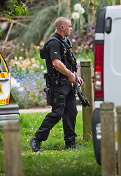 © London News Pictures. 24/05/2015. London, UK. An armed Police officer at Oxford University Parks in Oxford City centre, where police are currently searching for 21 year old Jed Allen who is wanted in connection with the deaths of a man, a woman and a girl, found at a property in Didcot,  Oxfordshire.. Photo credit: Ben Cawthra/LNP