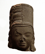 Head of Harihara  7th century, style of Phnom Da in Cambodia. sandstone, sculpture. Harihara is the name of a combined deity form of both Vishnu (Hari) and Shiva ( Hara) from the Hindu tradition. Also known as Shankaranarayana