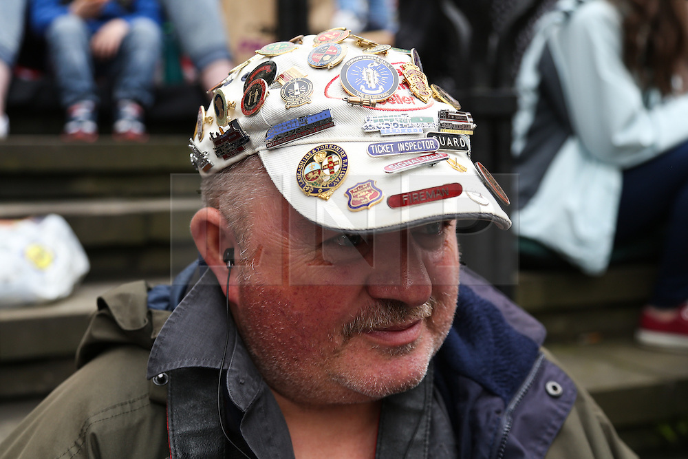 © Licensed to London News Pictures. 09/07/2016. Durham, UK. A man wearing a hat covered in badges at the Durham Miners' Gala in County Durham, UK. The gala is a large gathering held annually associated with the coal mining heritage and trade unionism. Photo credit : Ian Hinchliffe/LNP