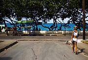 A woman walks down a street in Baracoa, Cuba on Saturday July 12, 2008.