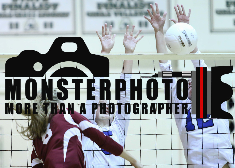 Charter school of wilmington Natalie Shannon (12) block the spike attempt during the 2nd Round of the 2015 DIAA Girls Volleyball Tournament Saturday, Nov. 07, 2015 at Archmere Academy in Claymont.