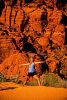 Woman doing yoga, Snow Canyon State Park, near Ivins (near St. George), Utah