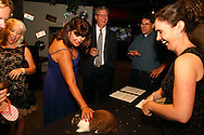 (from right) Melissa Proffitt of Middletown, Boonshoft curator of live animals mark Mazzei, Glenn Martin of Columbus, Luke, an American rabbit and Gail McCreight of Troy during the 2013 Boonshoft Gala at the Boonshoft Museum of Discovery in Dayton.  The theme, Hip to be Square, is reflected in exhibits and demonstrations during the evening.