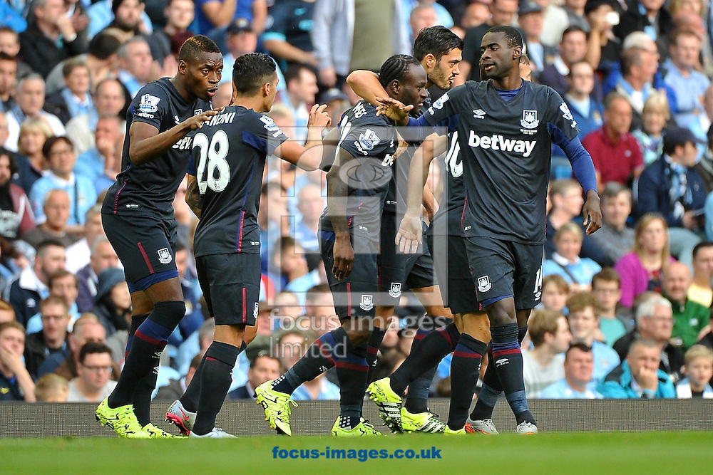 West Ham United players celebrate after Victor Moses  scoring their first goal to make it Manchester City 0 West Ham United 1 during the Barclays Premier League match at the Etihad Stadium, Manchester<br /> Picture by Ian Wadkins/Focus Images Ltd +44 7877 568959<br /> 19/09/2015