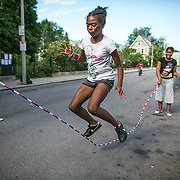 "09/01/2012  DORCHESTER, MA    Kaori Tate (cq) 10, plays jump rope during ""Playway,"" (cq) a block party on Coleman Street (cq) in Dorchester.   (Aram Boghosian for The Boston Globe)"