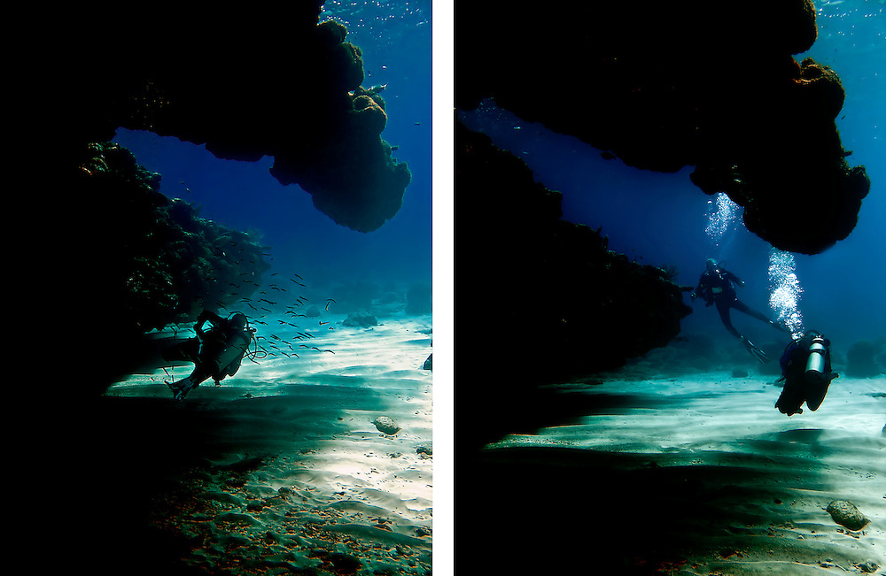 Divers emerge from cave off west coast of Roatan, Honduras.  Copyright 2010 Reid McNally.