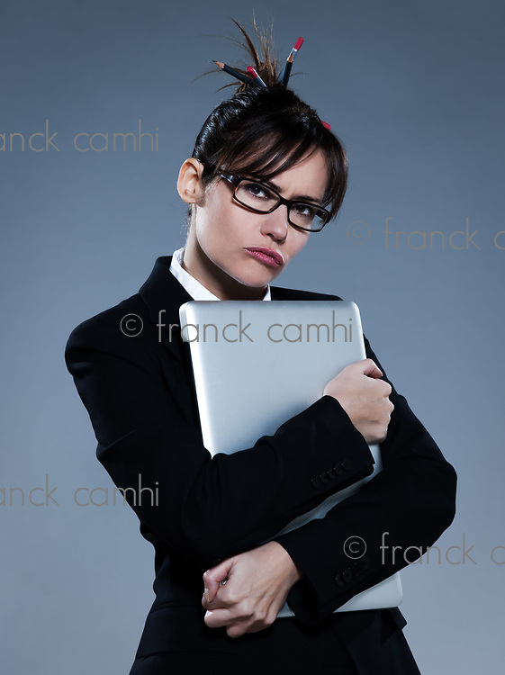 beautiful business woman hugging  her computer laptop on isolated bacground