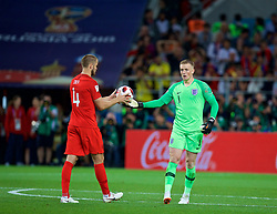 MOSCOW, RUSSIA - Tuesday, July 3, 2018: England's goalkeeper Jordan Pickford hands the ball to Eric Dier as he prepares to take his side's fifth penalty of the shoot-out during the FIFA World Cup Russia 2018 Round of 16 match between Colombia and England at the Spartak Stadium. (Pic by David Rawcliffe/Propaganda)
